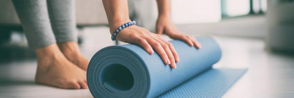 studio yoga class rolling mat